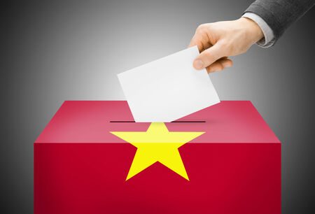Voting concept - Ballot box painted into Vietnam national flag Stock Photo