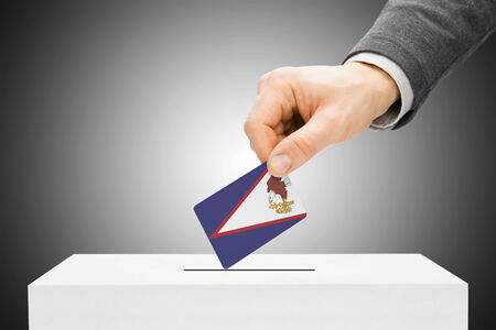 electoral system: Voting concept - Male inserting flag into ballot box - American Samoa Stock Photo