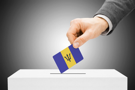 barbadian: Voting concept - Male inserting flag into ballot box - Barbados