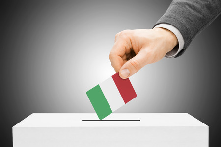 Voting concept - Male inserting flag into ballot box - Italy Stock Photo