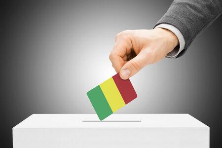 Voting concept - Male inserting flag into ballot box - Mali photo