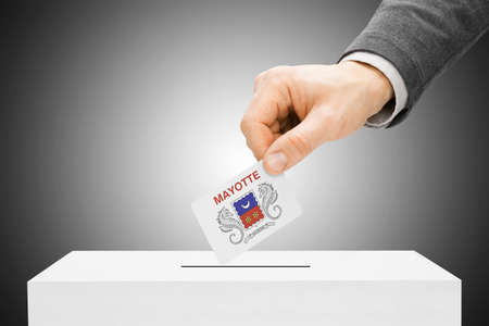 mayotte: Voting concept - Male inserting flag into ballot box - Department of Mayotte Stock Photo