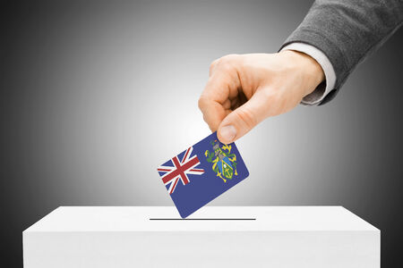 pitcairn: Voting concept - Male inserting flag into ballot box - Pitcairn Island
