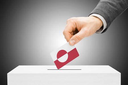 electoral system: Voting concept - Male inserting flag into ballot box - Greenland