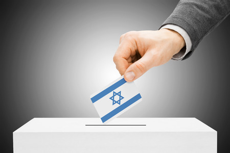 local election: Voting concept - Male inserting flag into ballot box - Israel