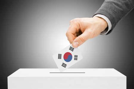 Voting concept - Male inserting flag into ballot box - South Korea