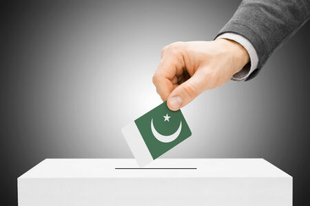 Voting concept - Male inserting flag into ballot box - Pakistan photo