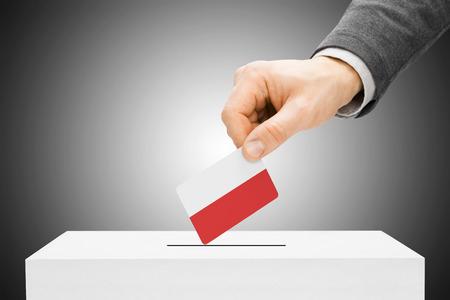 Voting concept - Male inserting flag into ballot box - Poland photo