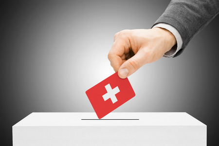 electoral system: Voting concept - Male inserting flag into ballot box - Switzerland
