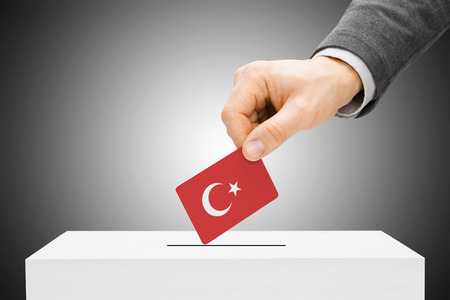 polling booth: Voting concept - Male inserting flag into ballot box - Turkey Stock Photo
