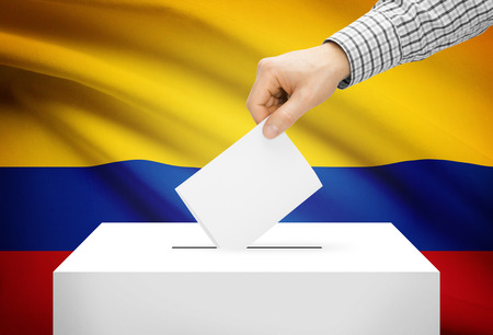 polling booth: Voting concept - Ballot box with national flag on background - Colombia