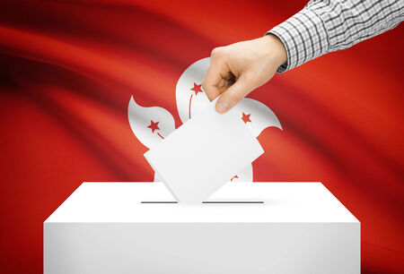 political system: Voting concept - Ballot box with national flag on background - Hong Kong
