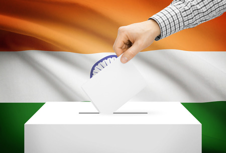 electoral: Voting concept - Ballot box with national flag on background - India