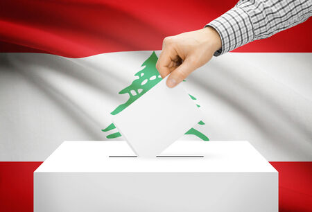 electoral system: Voting concept - Ballot box with national flag on background - Lebanon Stock Photo