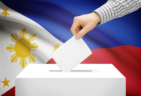 electoral system: Voting concept - Ballot box with national flag on background - Philippines