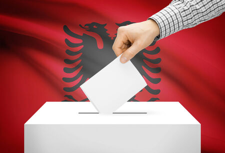 Voting concept - Ballot box with national flag on background - Albania photo