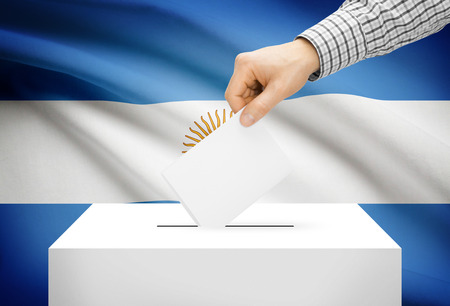 electoral: Voting concept - Ballot box with national flag on background - Argentina