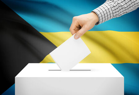 electoral system: Voting concept - Ballot box with national flag on background - Bahamas