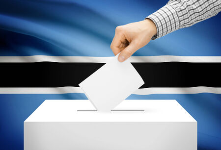 botswanan: Voting concept - Ballot box with national flag on background - Botswana