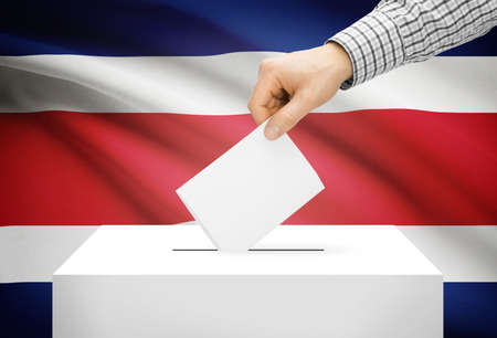 electoral system: Voting concept - Ballot box with national flag on background - Costa Rica