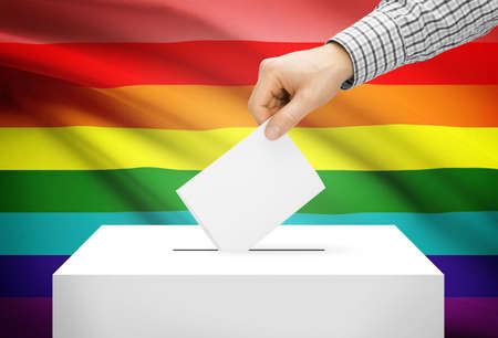 electoral system: Voting concept - Ballot box with national flag on background - LGBT flag Stock Photo