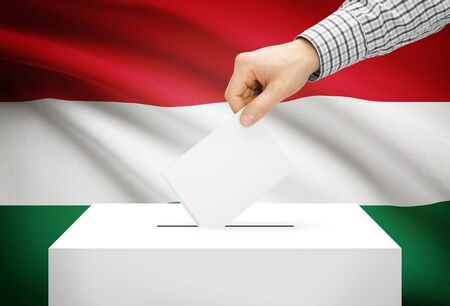 plebiscite: Voting concept - Ballot box with national flag on background - Hungary Stock Photo