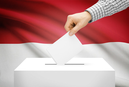 Voting concept - Ballot box with national flag on background - Indonesia