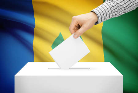 grenadines: Voting concept - Ballot box with national flag on background - Saint Vincent and the Grenadines Stock Photo
