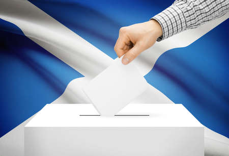 scottish parliament: Voting concept - Ballot box with national flag on background - Scotland Stock Photo
