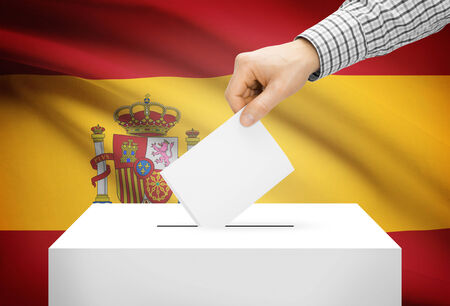 electoral system: Voting concept - Ballot box with national flag on background - Spain