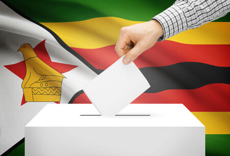 Voting concept - Ballot box with national flag on background - Zimbabwe photo