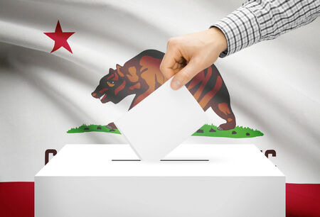 electoral system: Voting concept - Ballot box with national flag on background - California Stock Photo
