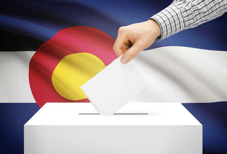 ballot box: Voting concept - Ballot box with national flag on background - Colorado Stock Photo
