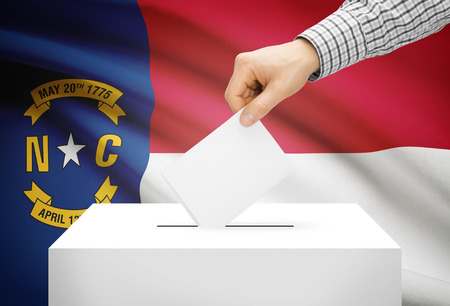 Voting concept - Ballot box with national flag on background - North Carolina