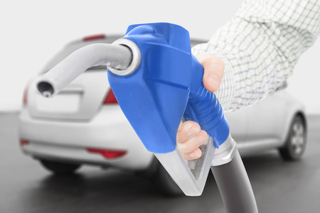 Blue color fuel pump gun with car on background Stock Photo