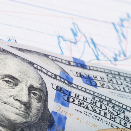 brent crude: Stock market chart and 100 USA dollars banknote - market concept Stock Photo