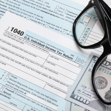Usa Tax Form 1040 With Glasses And 100 Us Dollar Bills Stock Photo