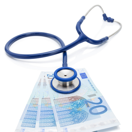 high cost of healthcare: EURO currency with stethoscope over it - healthcare concept