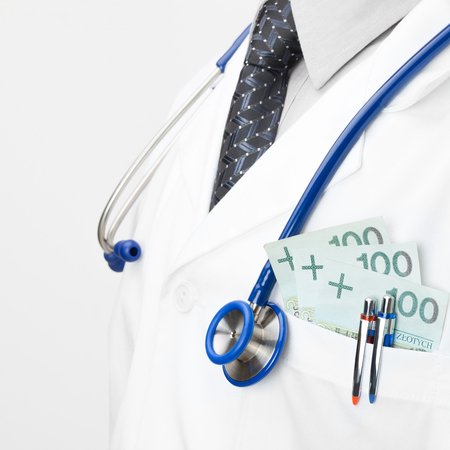 Doctor with money in his pocket - health care concept photo