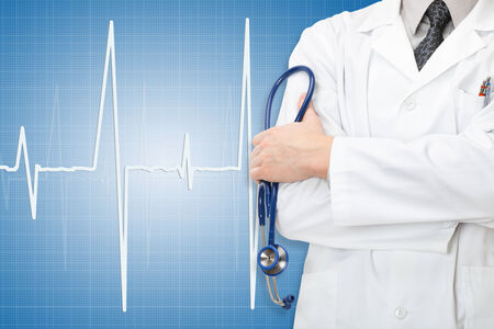 healthcare workers: Doctor with stethoscope in hand and electrocardiogram on blue background Stock Photo