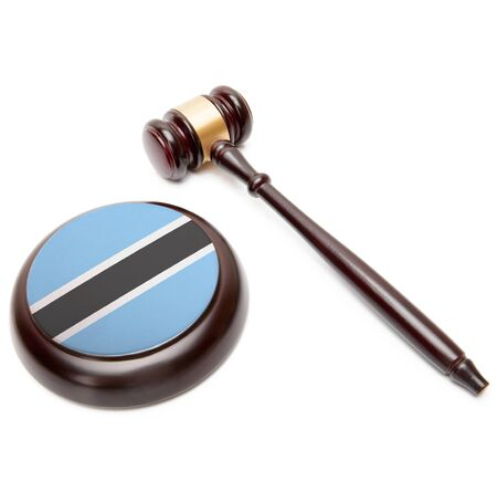 botswanan: Judge gavel and soundboard with national flag on it - Botswana