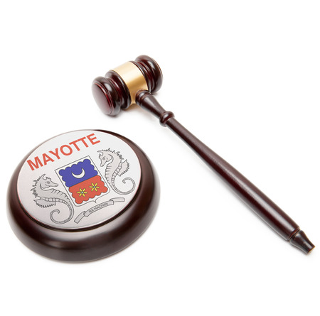 mayotte: Judge gavel and soundboard with national flag on it - Mayotte