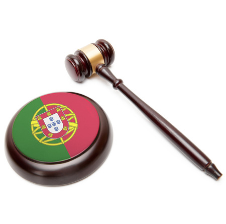 law of portugal: Judge gavel and soundboard with national flag on it - Portugal