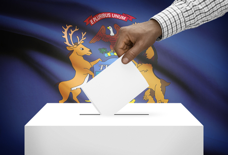 ballot box: Voting concept - Ballot box with US state flag on background - Michigan Stock Photo