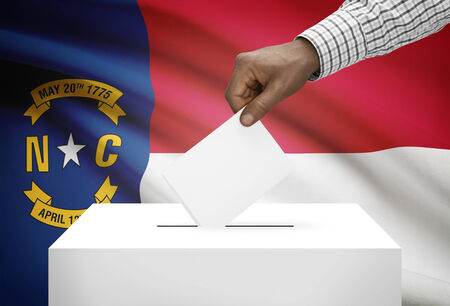 ballot box: Voting concept - Ballot box with US state flag on background - North Carolina
