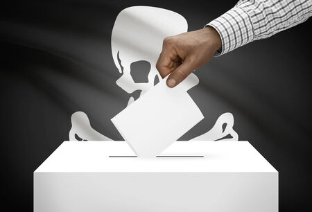 jolly roger: Voting concept - Ballot box with flag on background - Jolly Roger flag Stock Photo