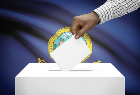electoral system: Voting concept - Ballot box with US state flag on background - Idaho