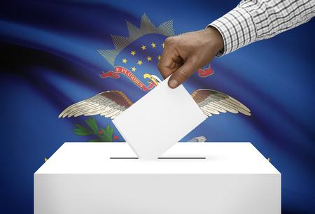 ballot box: Voting concept - Ballot box with US state flag on background - North Dakota