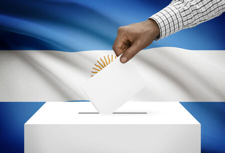 Ballot box with national flag on background - Argentina photo