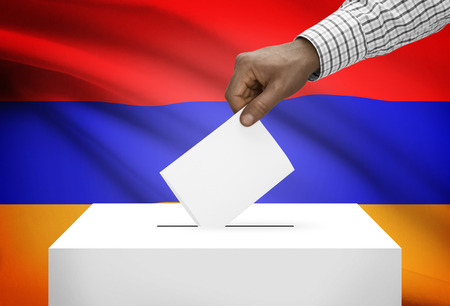 electoral system: Ballot box with national flag on background - Armenia